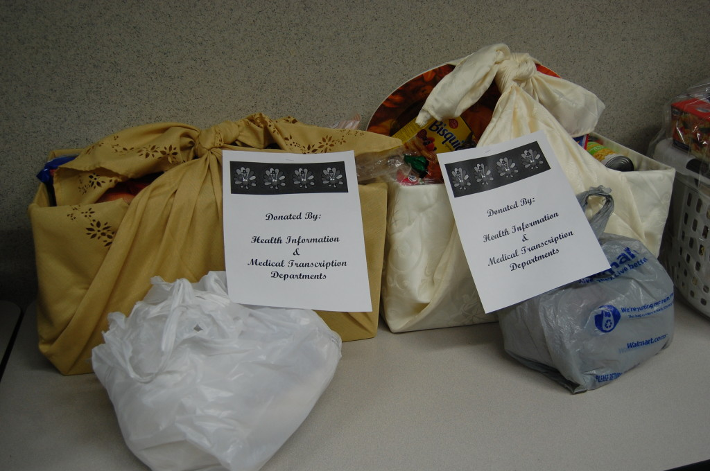 Thanksgiving baskets wrapped in a cloth tablecloth.
