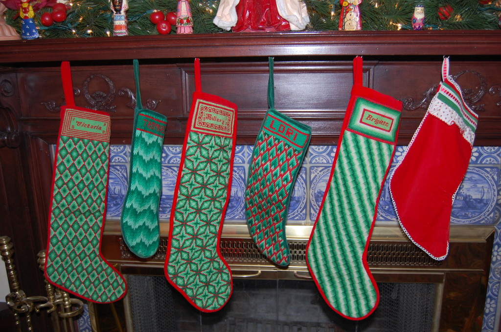 Lori has handmade needlepoint stockings that are hung with care.