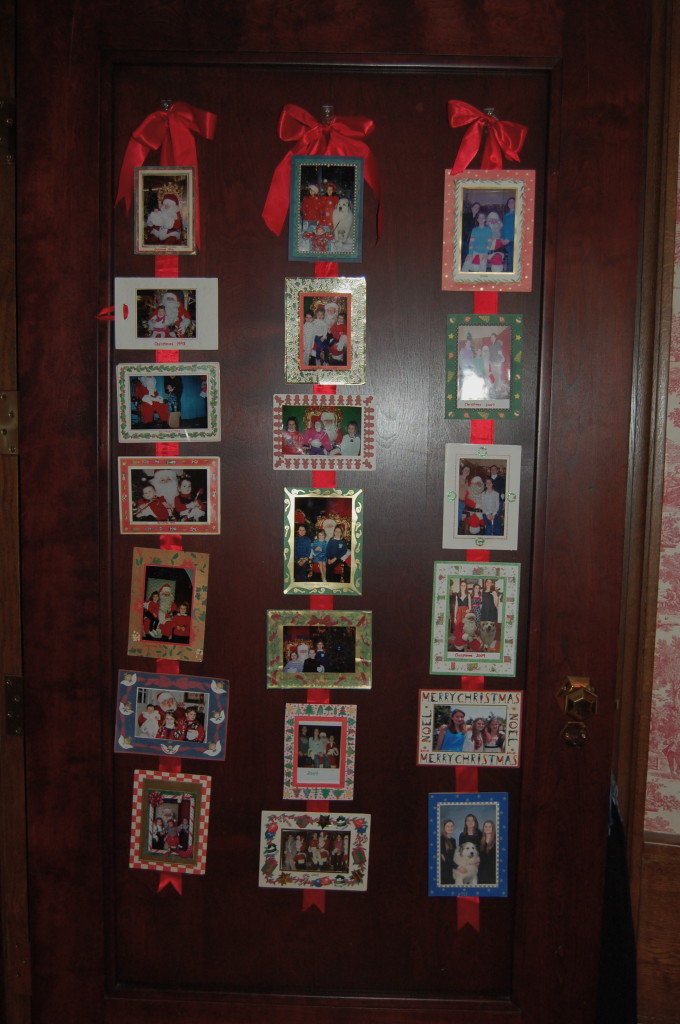 My favorite discovery! Lori has made a display of all her photo Christmas cards beginning in 1992 the year their first daughter arrived. Santa and Kirby the dogs are frequently featured.